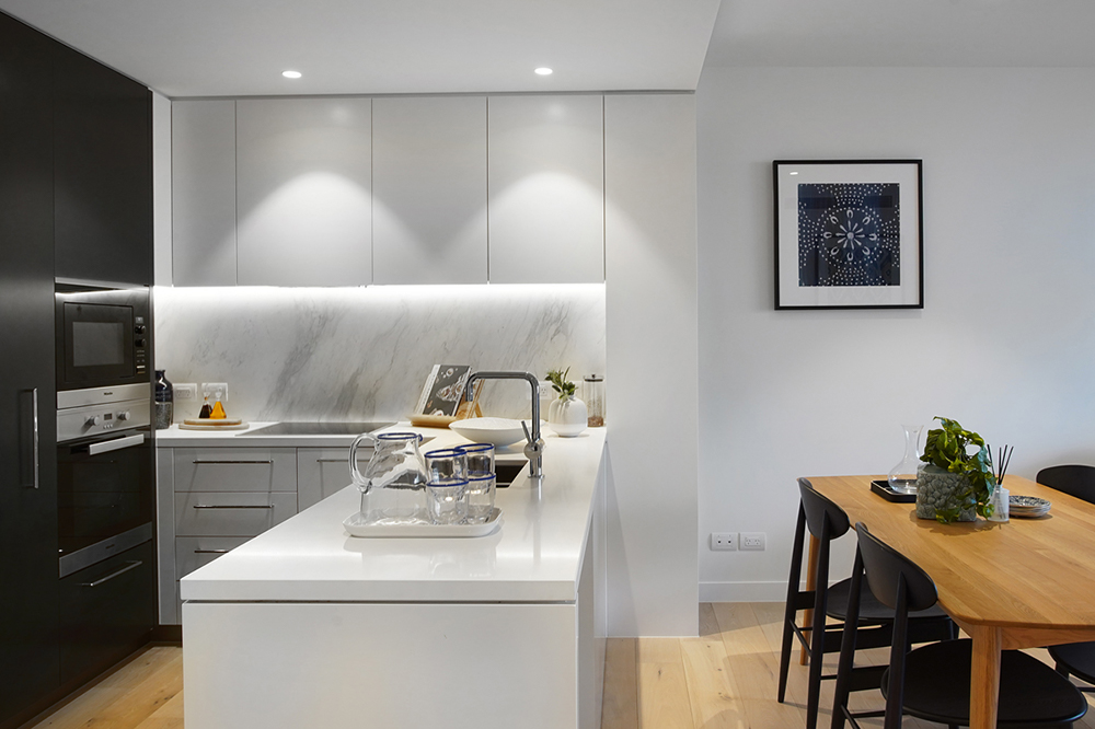 Open plan kitchen and living at Drummond Place Carlton