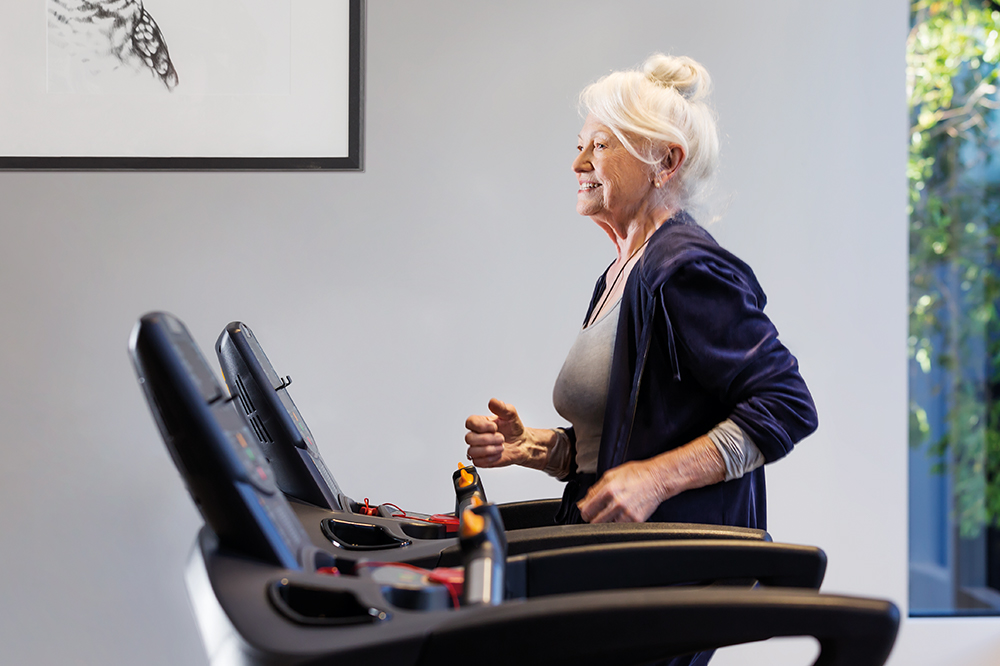 Senior woman exercising in the gym at Drummond Place Carlton